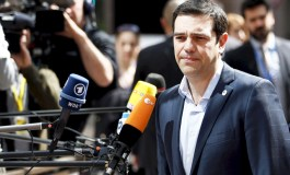 Tsipras presses for early Greek debt deal but flags referendum