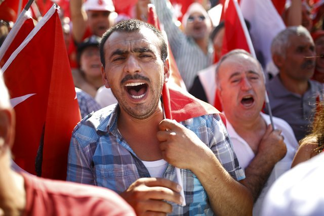 Supporters of various political parties gather in Istanbul's Taksim Square