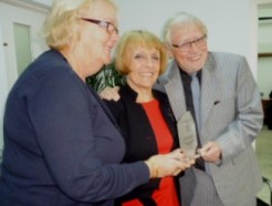 Jenny Tyler, Brenda Plant, Mike Plant with an award