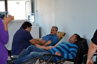 Donors giving blood. at the Tatlisu blood donor day
