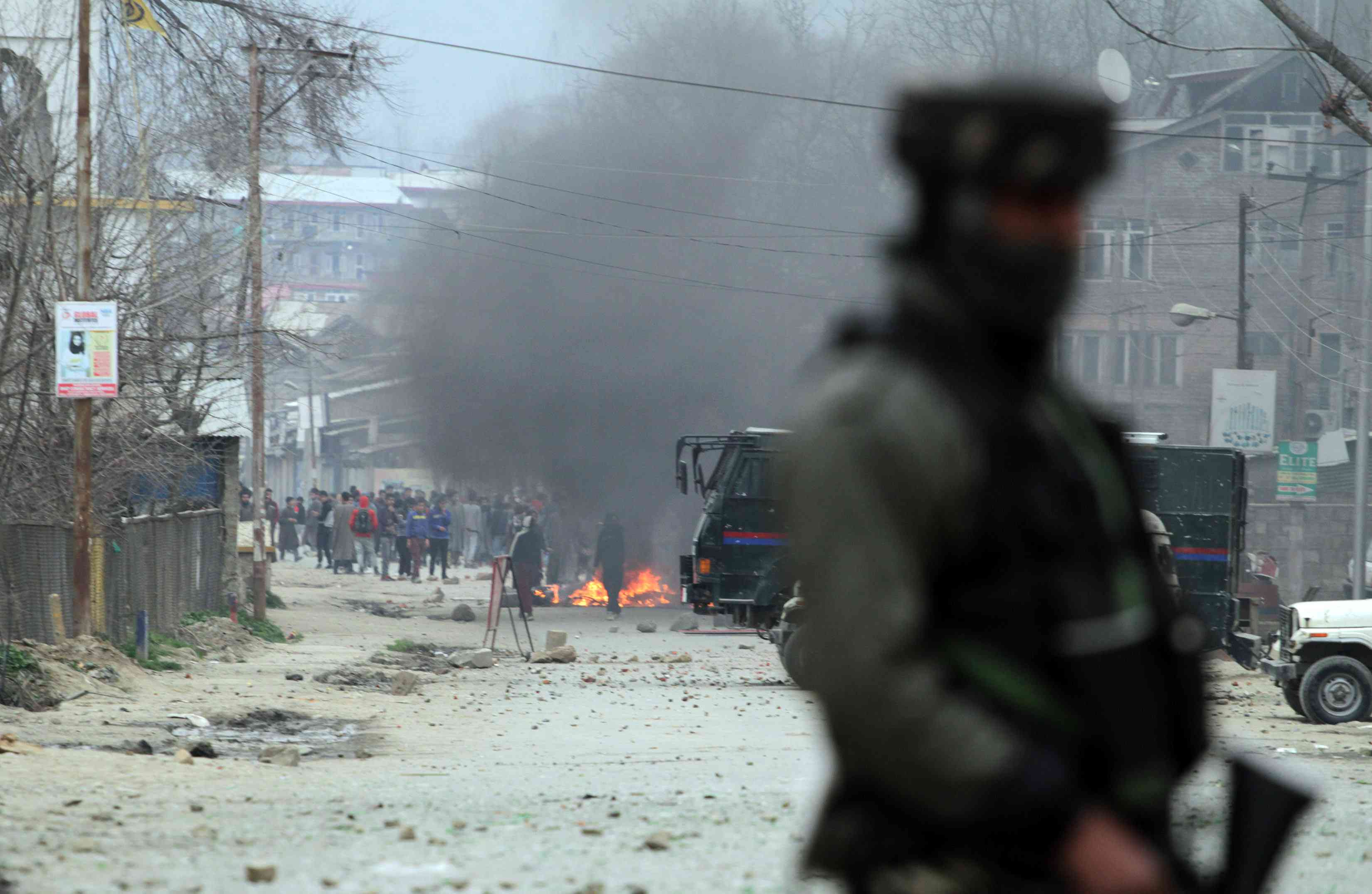 The scene outside Rizwan Pandit's house in Awantipora on Tuesday. (Photo credit: Safwat Zargar).