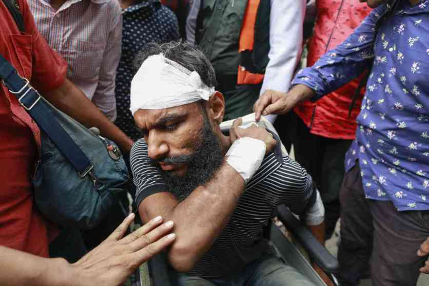 Associated Press photographer AM Ahad leaves a hospital after he was beaten by ruling party activists during a student demonstration to protest against the deaths of two students in a road accident, in Dhaka, on August 5, 2018. (Photo credit: AFP).