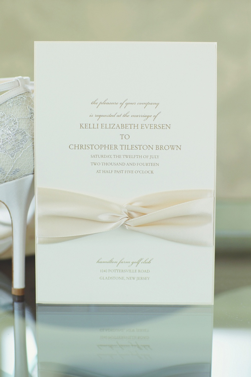 ribbon tied wedding invitation wedding invitations with ribbon Simple invite with ivory ribbon and gold lettering