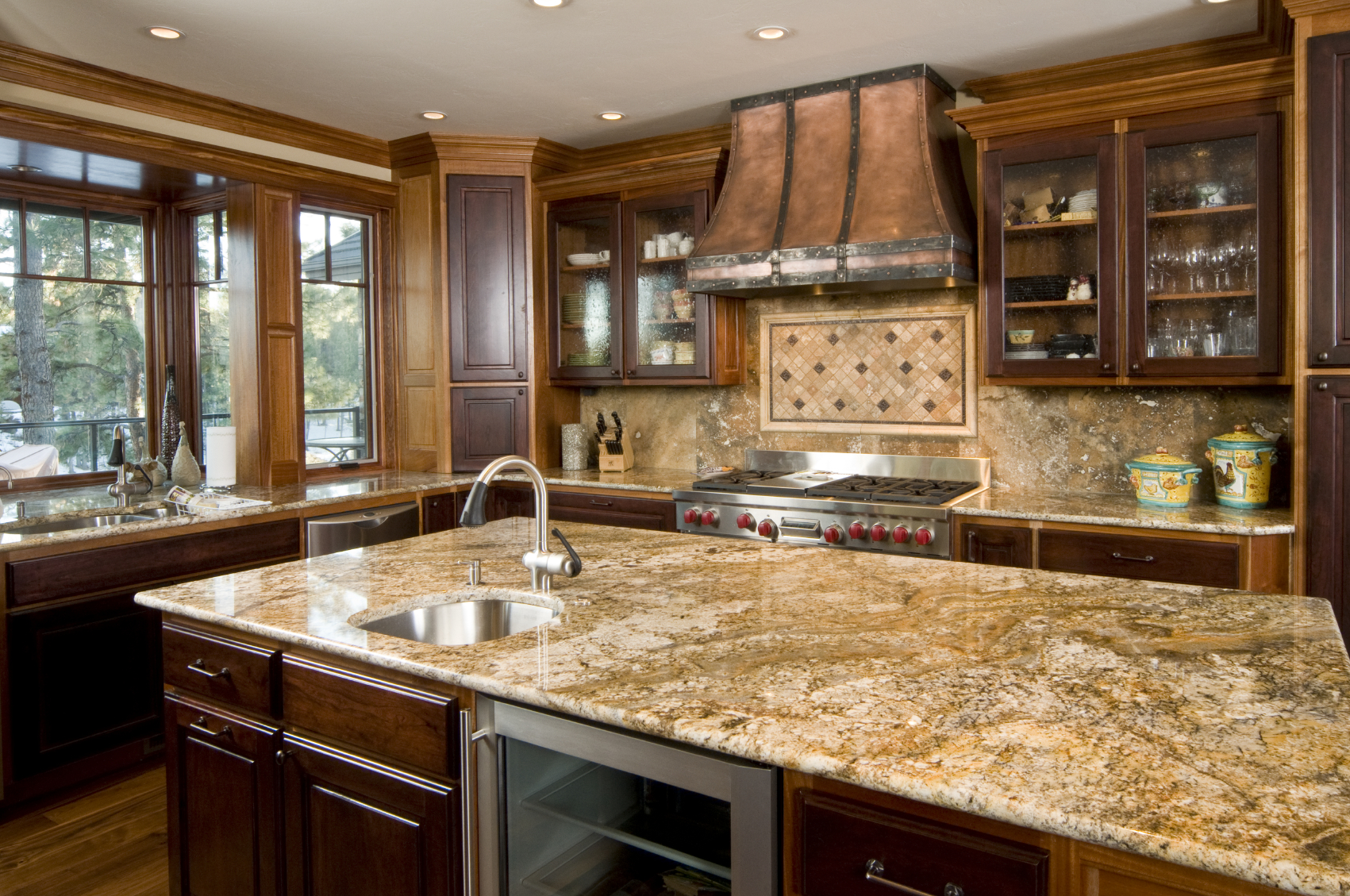 contemporary wood kitchens kitchen cabinet countertop Copper tones unify this kitchen featuring dark wood cupboard doors over lighter toned cabinetry with