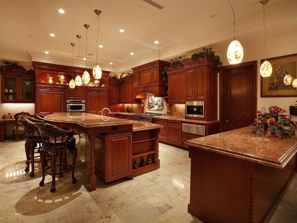 dark kitchen cabinets brown kitchen cabinets Luxurious open kitchen with stained wood cabinetry and large two tier island at
