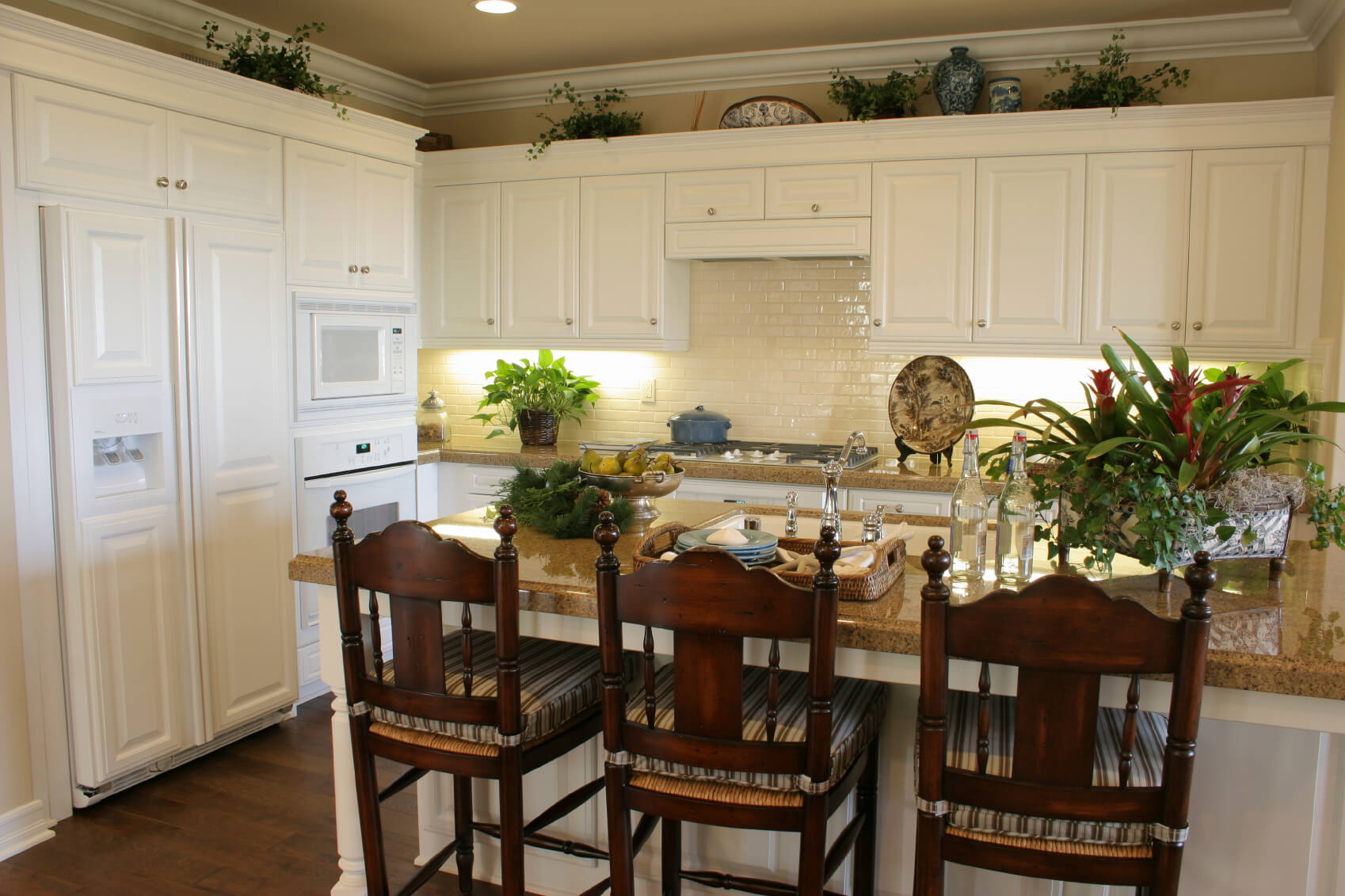 white kitchen designs pictures kitchen cabinet countertop White matte cabinetry paired with glossy white brick backsplash over brown marble countertops pulls this kitchen