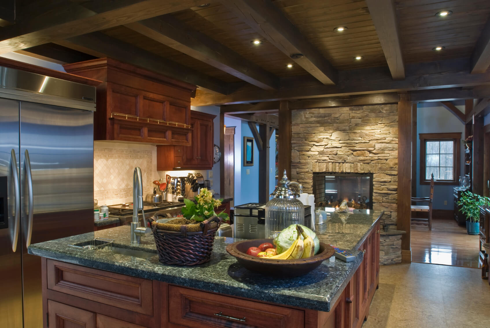 dark kitchen cabinets cherry wood cabinets kitchen Rustic look kitchen features brick pass through fireplace under dark wood exposed beams with
