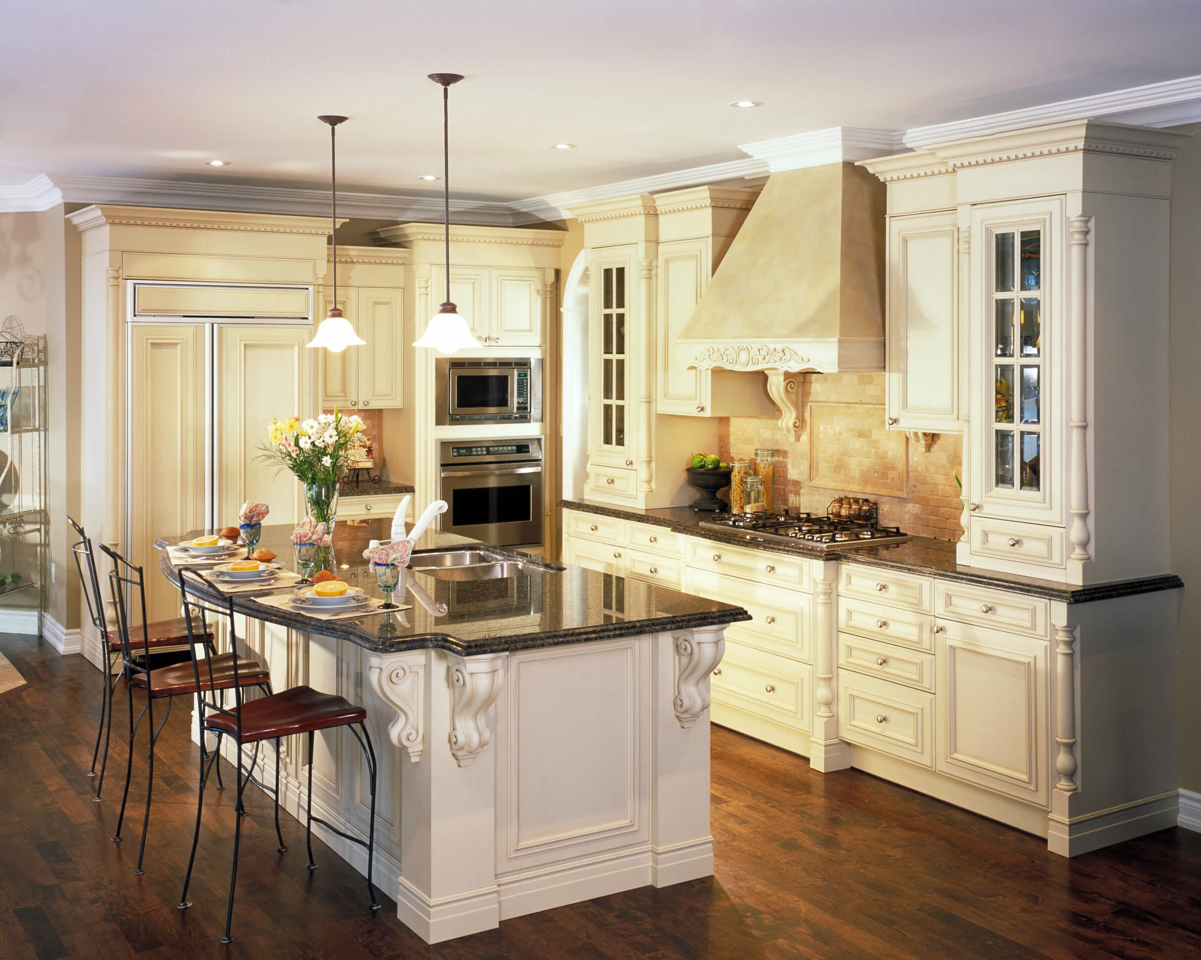 dream kitchen designs wood kitchen countertops Kitchen featuring great contrast between dark wood flooring white cabinetry and black marble countertops