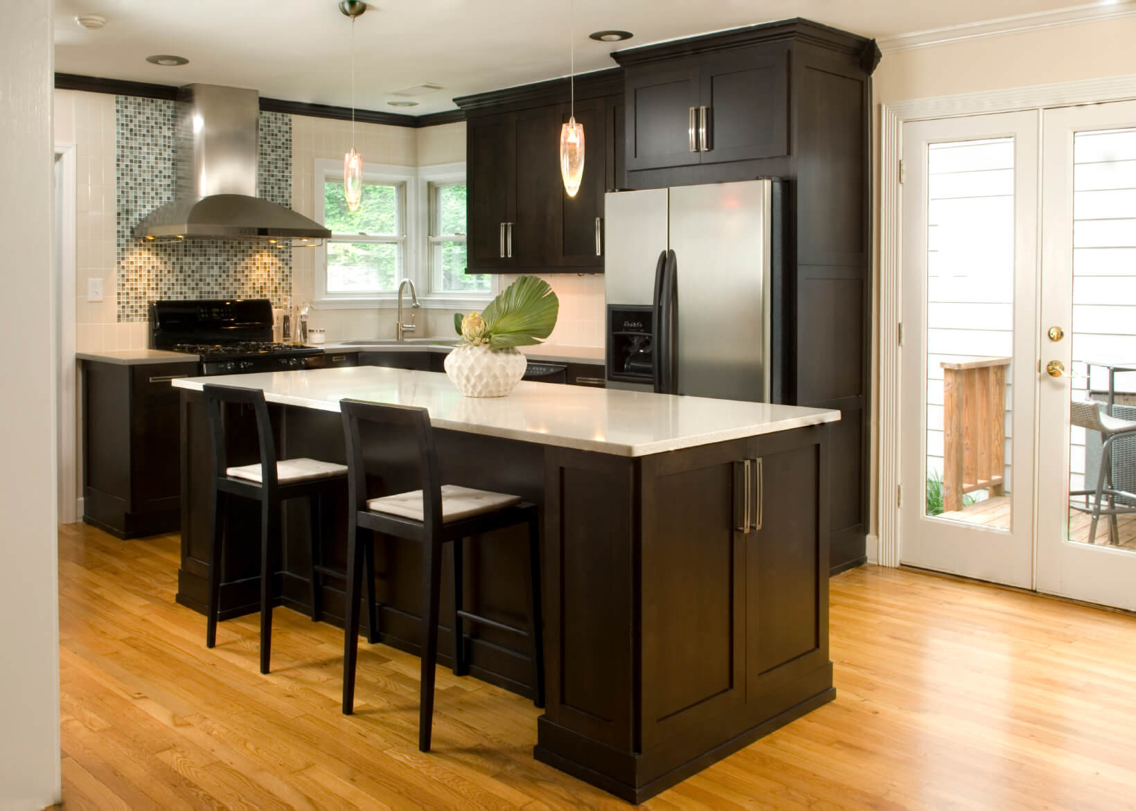 dark kitchen cabinets kitchen cabinet countertop High contrast white wall kitchen with dark wood paneling and cupboards paired with white countertops