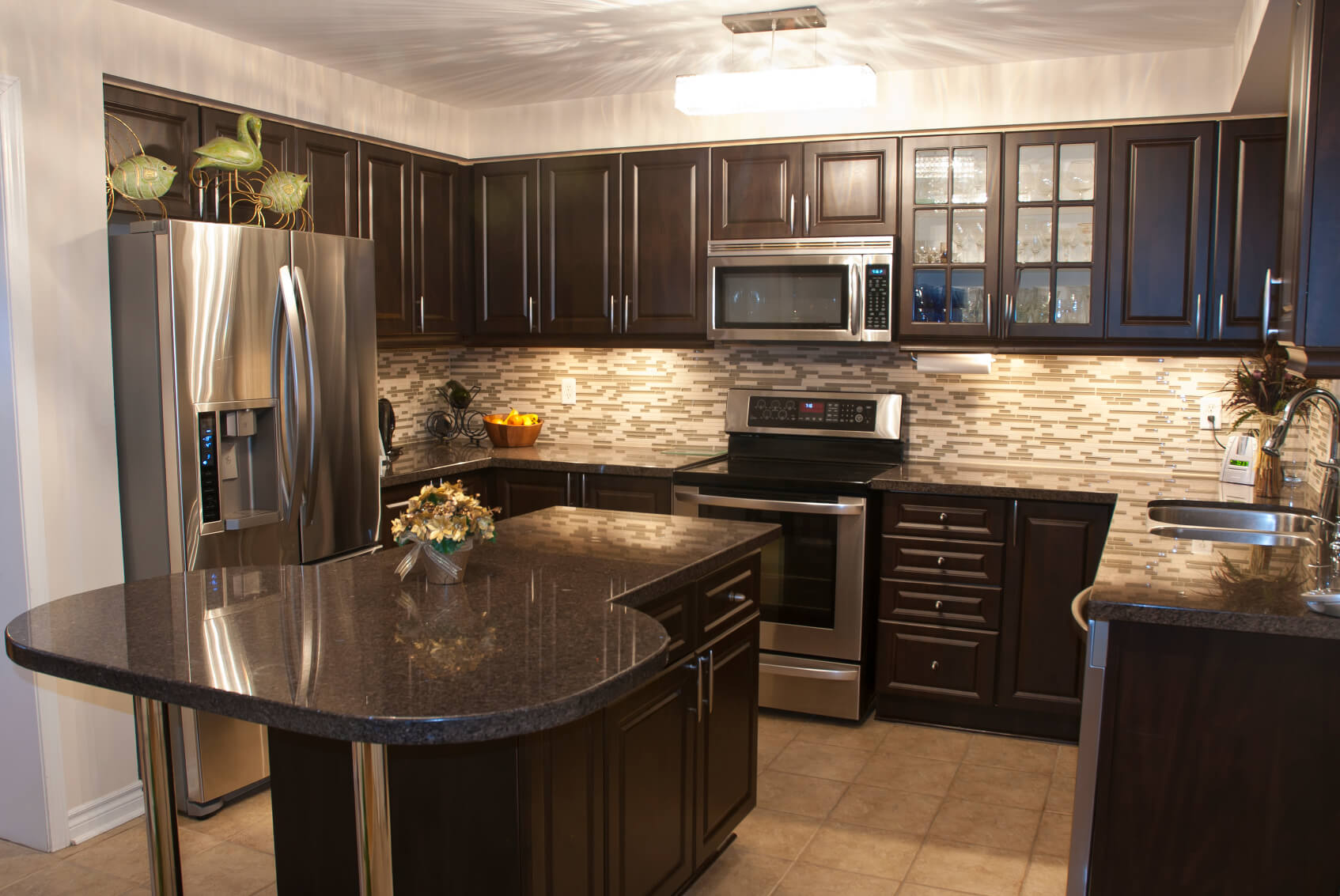 dark kitchen cabinets kitchen black cabinets Cozy kitchen is stuffed with dark wood cabinetry with brushed metal hardware Black marble