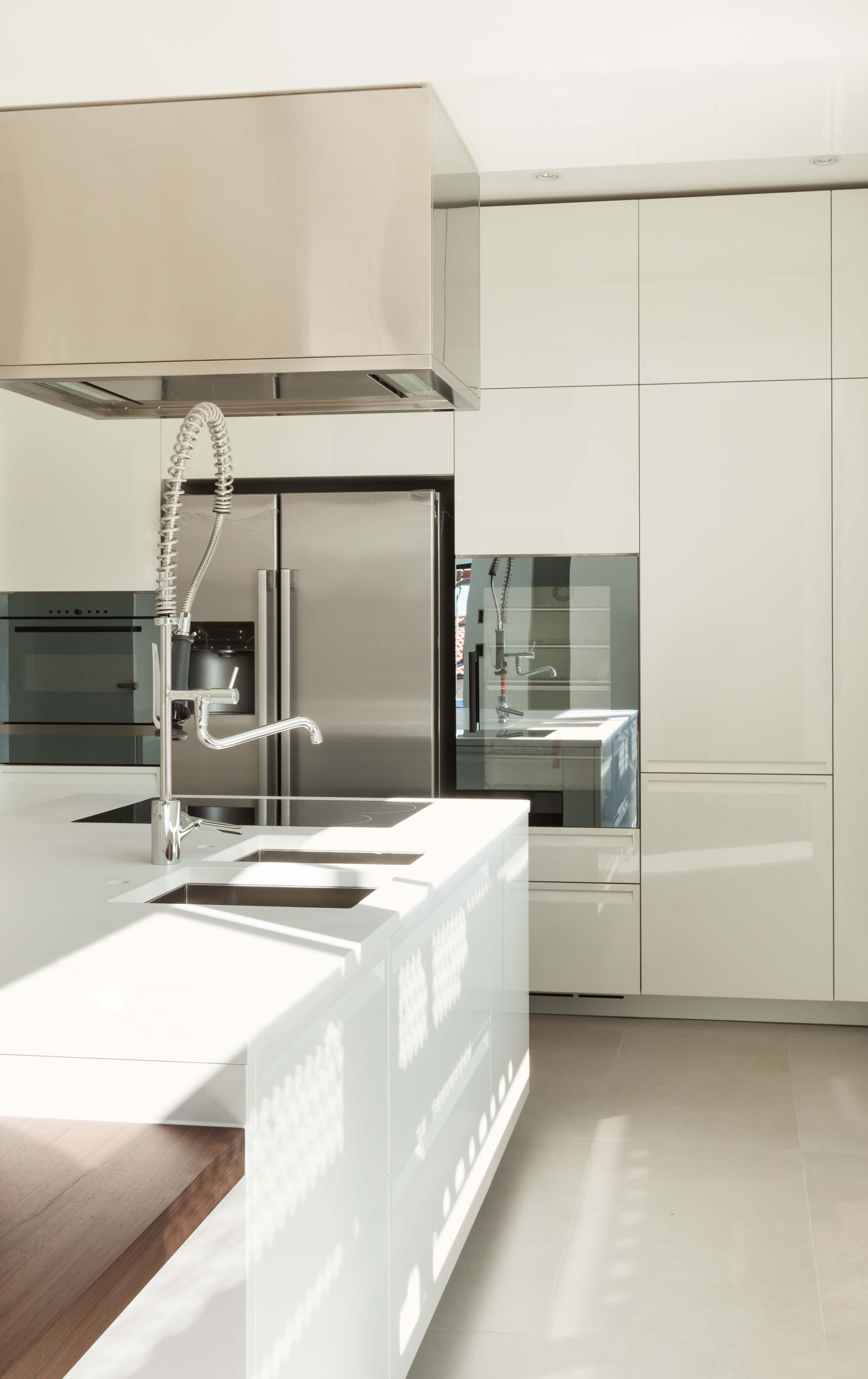 white kitchen designs pictures beige kitchen cabinets Ultra modern slick surfaces abound in this kitchen featuring glossy white cabinetry and countertops over