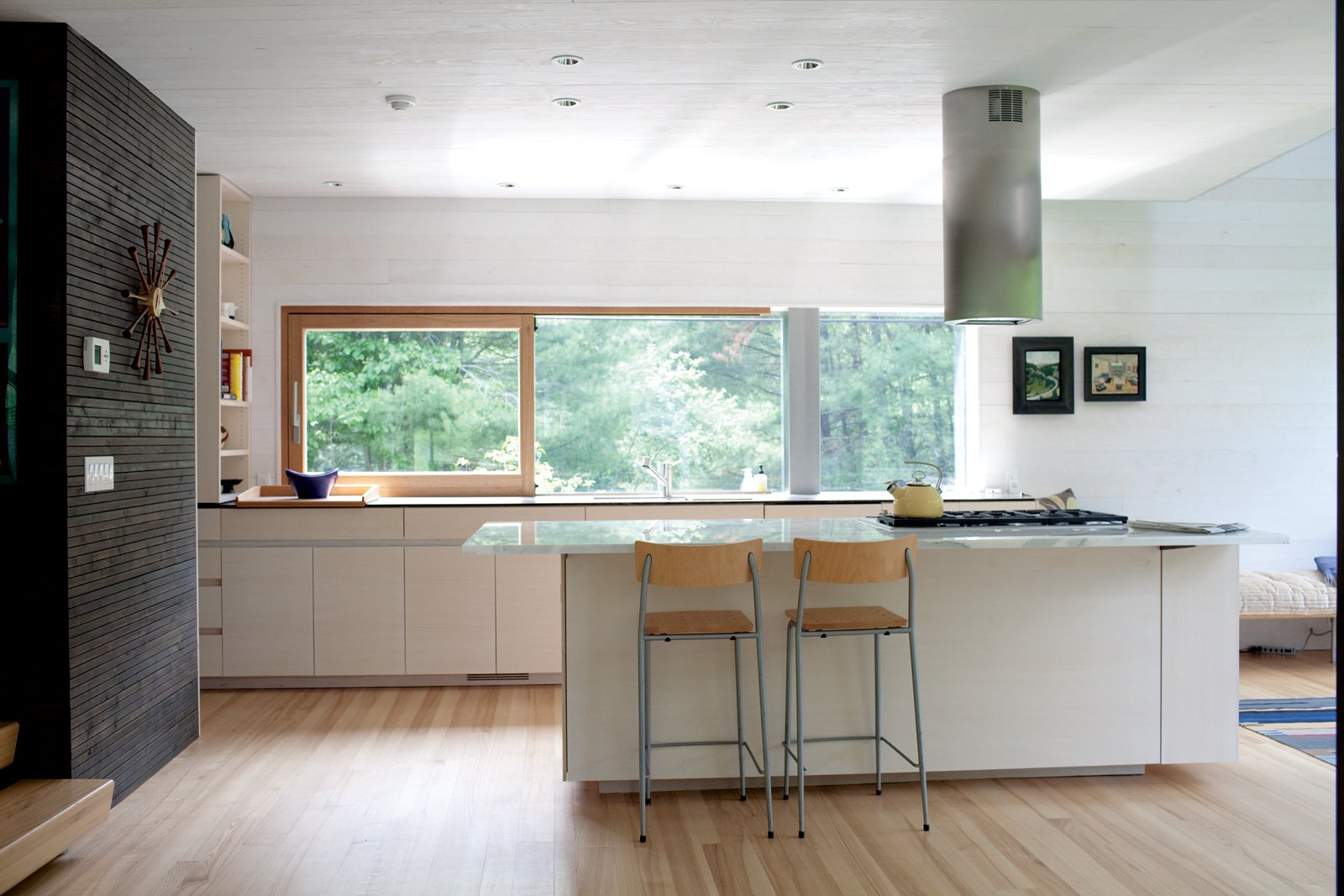 ash kitchen cabinets In the kitchen a Sirius range hood hovers over a Wolf cooktop The bleached