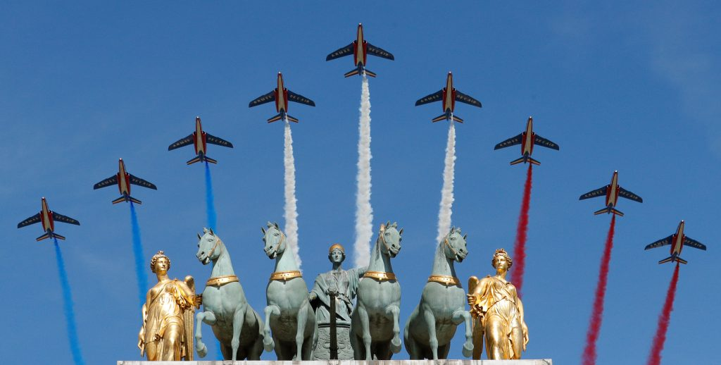 PHOTOS  Tanks  jets and U S  troops at this year s Bastille Day     Alpha jets from the French Air Force Patrouille de France fly over the Arc  de Triomphe