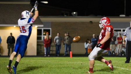 James Ligenfelter of Kane blocks a punt leading to a touchdown in Kane's win over Cameron County - Photo by Shawn Murray
