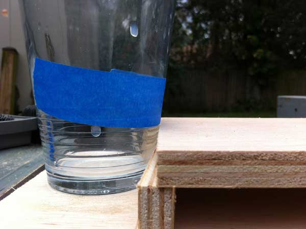 Here's my super-technical way to determine the depth of the glass and then find the radius of the cupholder.