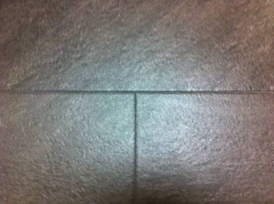 The grout dried to nearly the same color as the tiles. I like the look.