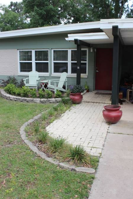 create curb appeal for your home by planting plants, painting your front door and adding container plants DIY