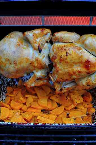 Chickens with sweet potatoes in the drip pan