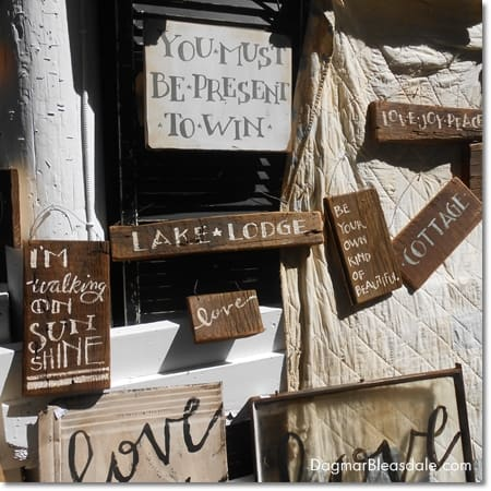 wooden signs with quotes and inspiring words