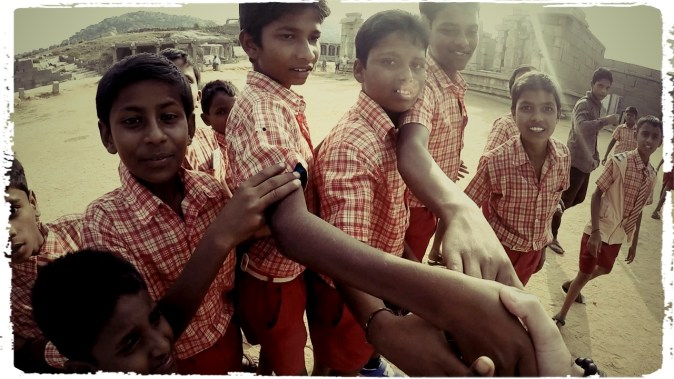 dagsvstheworld, motorcycle through india, hampi, rtw trip motorcycle, wanderlust, adventure, mumbai, amanita caves, hindu, indian school kids