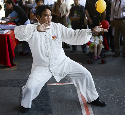 Tai Chi practioner Rong Bing Zhang performs a Tai Chi demonstration at the annual Community Welcome Fair for Immigrants and Newcomers, organized by the Ottawa Chinese Community Service Centre (OCCSC) on Sunday, June 1, 2014. (James Park / Ottawa Citizen)