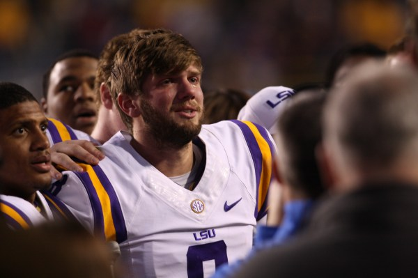 QB Zach Mettenberger celebrates with the team as they sing the LSU Alma mater song.
