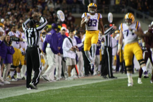 LSU wr Travin Dural was rounding the corner before getting pushed out of bounds....   and decided to go airborne.