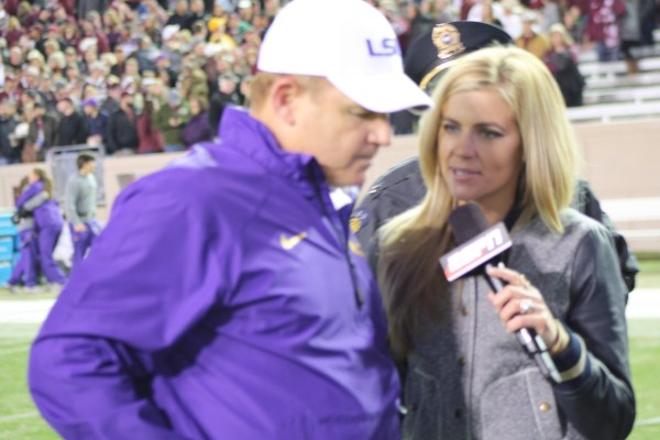 LSU coach Les Miles speaks to ESPN reporter after the game as LSU beats Texas AM 23-17.