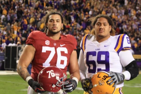 Alabama DL Dominick Jackson and LSU G Hoko Fanaika hanging out after the LSU vs Alabama Game.
