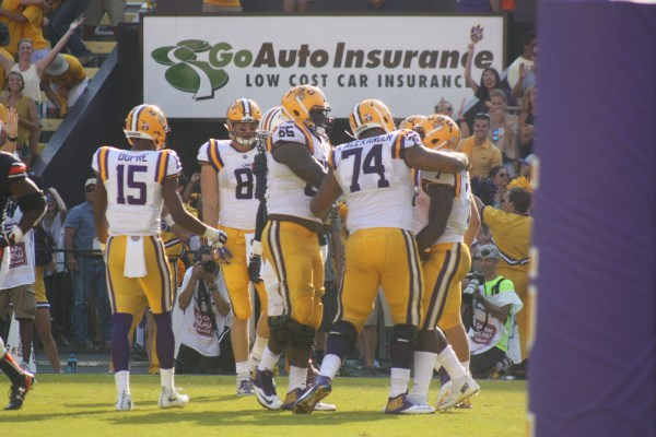 The LSU Line celebrates with Leonard Fournette after his 2nd td of the day.