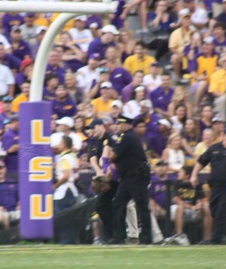 A LSU Fan will be spending a 3 day weekend in the county jail as he tried to run across the field, when the policeman corner him he gave up running.