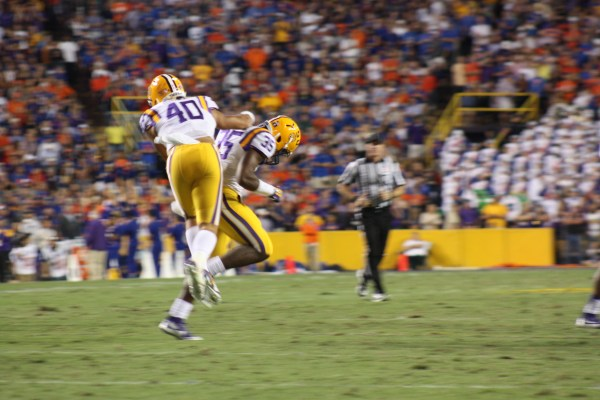 LSU Duke Riley gets fired up after a play.