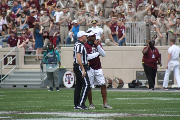 Coach Sumlin having a talk with the ref.