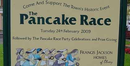 563px-UK_Olney_(Pancake_Sign)