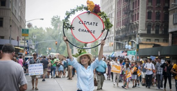 A woman holds a sign against climate change in Midtown Manhattan in New York on Sept. 21, 2014, while taking part in the People's Climate March calling for action against climate change. (Photo: Richard B. Levine/Newscom)
