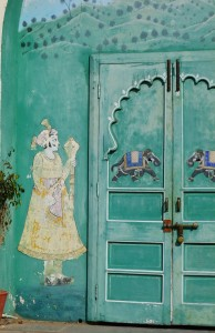 Painting of a Royal Person Next to Doors with Elephants