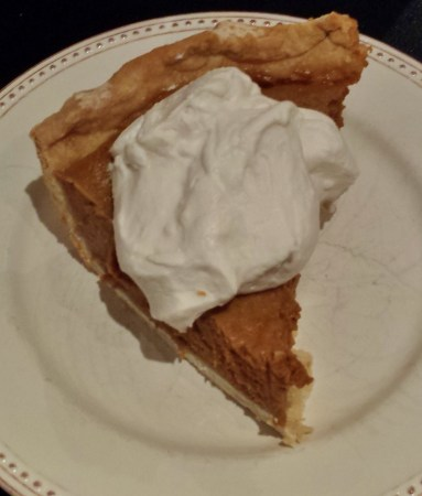 Pumpkin Pie Slice with Coconut Whipped Cream