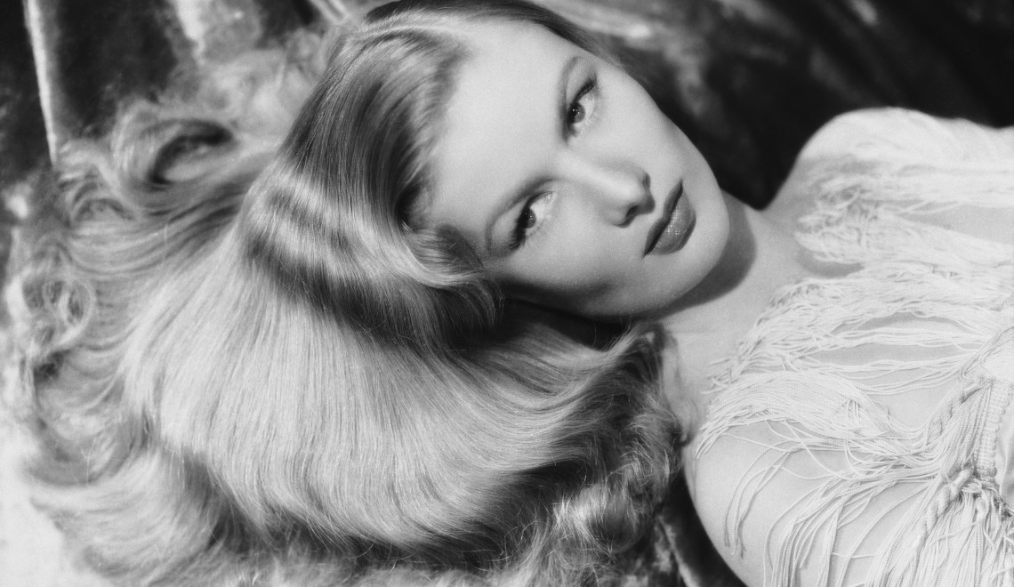 1942:  American actress Veronica Lake (1919 - 1973) lies with her golden locks fanning out around her face.  (Photo by George Hurrell/John Kobal Foundation/Getty Images)