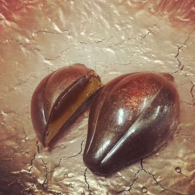 GLASS IS A LIQUID - dark butter caramel atop pistachio gianduja. Long and rich in the mouth. #dlcbonbons #chocolatier #chocolateasart #gianduja #caramel #dessertprofessional #ecolechocolat #ecolechocolatmanchester #finechocolateindustryassociation #finechocolate #artisanchocolate #visitnh