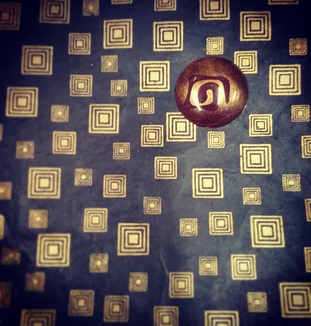 HYPNOPHOBE - Citrus & mango cloud caramel in a thin (spinning) is a disk.#dlcbonbons #chocolatier #chocolateasart #chocolate #visitmanchesternh #illusion #bonbon
