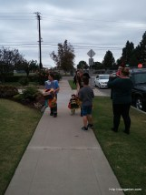 Abigail walking with her cousins for her first trick or treating.