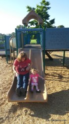 Going down a slide with Grammy Pammy