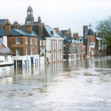 """""""The Ouse in flood. York - geograph.org.uk - 126451"""" by Gordon Hatton. Licensed under CC BY-SA 2.0 via Commons - https://commons.wikimedia.org/wiki/File:The_Ouse_in_flood._York_-_geograph.org.uk_-_126451.jpg#/media/File:The_Ouse_in_flood._York_-_geograph.org.uk_-_126451.jpg"""