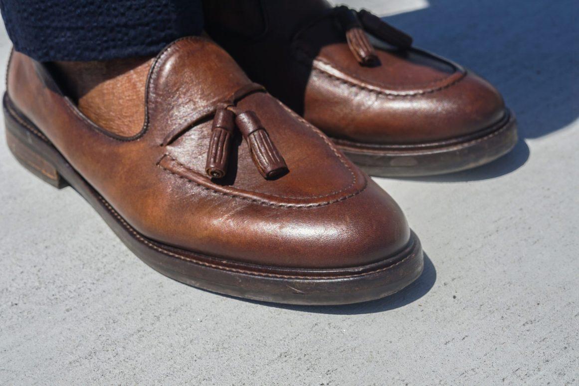 dapper advisor-black man wearing-brown leather tassel loafers