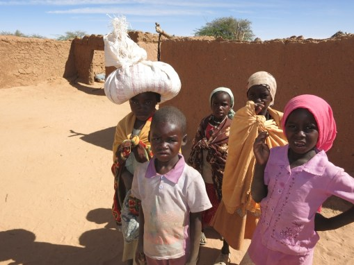 9. Community: right when a mother is telling me that she has no more food, a neighbor girl shows up with a bag of grain on her head for the family in need.