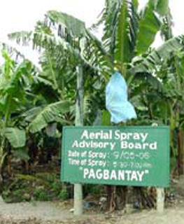 A sign in a Lapanday plantation warns people about aerial spraying.