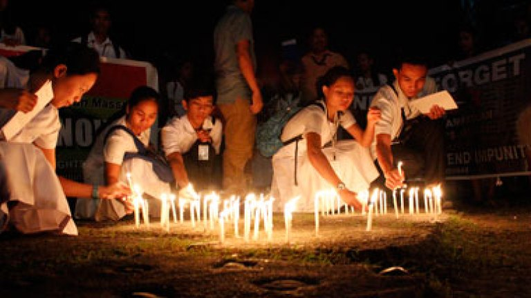 REMEMBERING THE VICTIMS. Students of the Assumption College of Davao light candles on Thursday outside the Redemptorist Church in Davao City. They remember the 58 individuals who were brutally killed in Ampatuan, Maguindanao Province three years ago. (davaotoday.com photo by Medel V. Hernani)