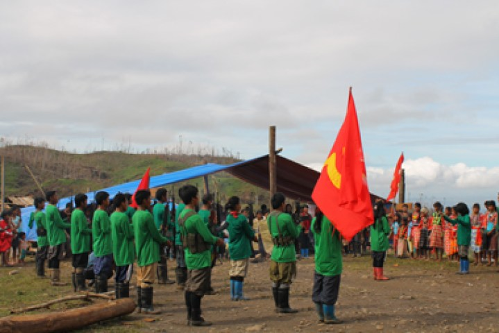 COMMUNITY SINGING. Somewhere in Agusan del Sur, NPA fighters sing the Internationale with the lumads Wednesday during the 44th anniversary of the re-establishment of the Communist Party of the Philippines. (davaotoday.com photo by Jayboy A. Urbina)