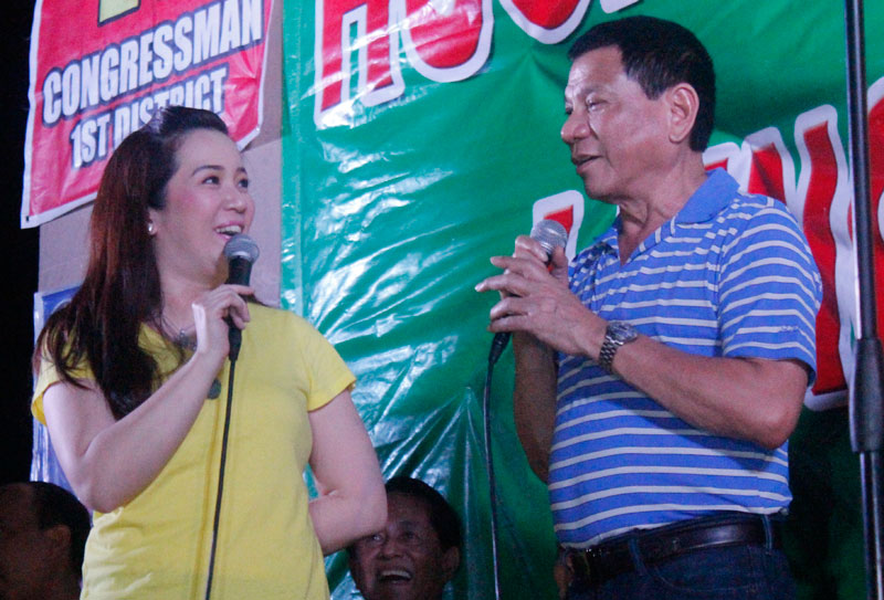KRIS & RODY. Presidential sister and celebrity Kris Aquino (left) asks Davao City Vice Mayor Rodrigo Duterte's support for her planned candidacy in the 2016 elections during the campaign rally Thursday night. (davaotoday.com photo by John Rizle L. Saligumba)