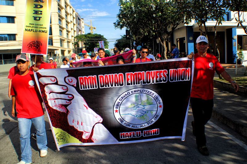 Employees of the Radio Mindanao Network join the 127th celebration of International Labor Day, Wednesday in Davao City.  (davaotoday.com photo by Ace R. Morandante)